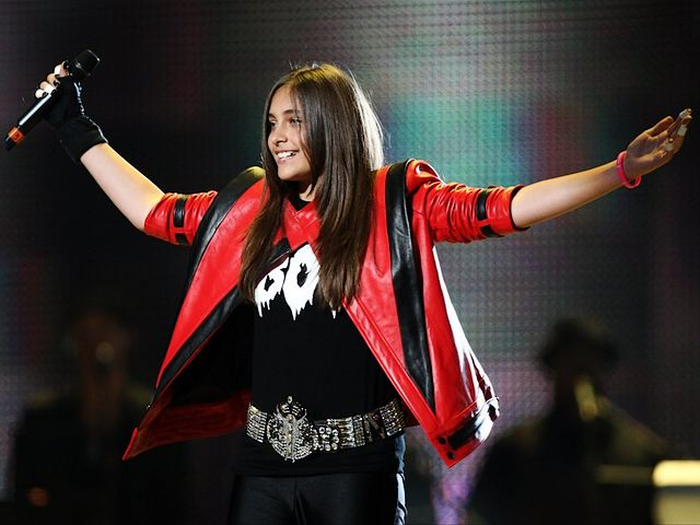 Michael Forever Tribute Concert Paris Jackson on Stage at Millennium Stadium in Cardiff Wales UK - Paris-Michael Katherine Jackson, the daughter of the late King of Pop Michael Jackson, in a classic red and black leather jacket as of her dad, on stage, during the tribute concert 'Michael Forever' at the Millennium Stadium in Cardiff, the capital of Wales, UK (October 8, 2011). - , Michael, Forever, tribute, concert, concerts, Paris, Jackson, stage, stages, Millennium, Stadium, stadiums, Cardiff, Wales, UK, music, musics, celebrities, celebrity, place, places, travel, travels, trip, trips, tour, tours, Katherine, daughter, daughters, late, king, kings, pop, classic, red, black, leather, jacket, jackets, capital, capitals, October, 2011 - Paris-Michael Katherine Jackson, the daughter of the late King of Pop Michael Jackson, in a classic red and black leather jacket as of her dad, on stage, during the tribute concert 'Michael Forever' at the Millennium Stadium in Cardiff, the capital of Wales, UK (October 8, 2011). Solve free online Michael Forever Tribute Concert Paris Jackson on Stage at Millennium Stadium in Cardiff Wales UK puzzle games or send Michael Forever Tribute Concert Paris Jackson on Stage at Millennium Stadium in Cardiff Wales UK puzzle game greeting ecards  from puzzles-games.eu.. Michael Forever Tribute Concert Paris Jackson on Stage at Millennium Stadium in Cardiff Wales UK puzzle, puzzles, puzzles games, puzzles-games.eu, puzzle games, online puzzle games, free puzzle games, free online puzzle games, Michael Forever Tribute Concert Paris Jackson on Stage at Millennium Stadium in Cardiff Wales UK free puzzle game, Michael Forever Tribute Concert Paris Jackson on Stage at Millennium Stadium in Cardiff Wales UK online puzzle game, jigsaw puzzles, Michael Forever Tribute Concert Paris Jackson on Stage at Millennium Stadium in Cardiff Wales UK jigsaw puzzle, jigsaw puzzle games, jigsaw puzzles games, Michael Forever Tribute Concert Paris Jackson on Stage at Millennium Stadium in Cardiff Wales UK puzzle game ecard, puzzles games ecards, Michael Forever Tribute Concert Paris Jackson on Stage at Millennium Stadium in Cardiff Wales UK puzzle game greeting ecard