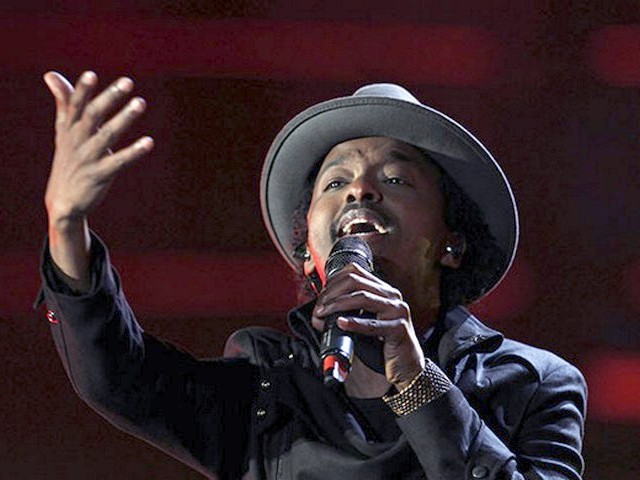 World Cup 2010 Kick-off Concert KNaan - The Somali-Canadian rapper K'Naan performs 'Wavin' Flag' the official soccer song of the FIFA World Cup 2010 and the 'Coca-Cola' Anthem during the Kick-off concert at the Orlando stadium in Soweto, Johannesburg, South Africa (June 10, 2010). - , World, Cup, 2010, Kick-off, concert, K'Naan, music, musics, performance, performances, party, parties, show, shows, celebration, celebrations, sport, sports, tournament, tournaments, Somali-Canadian, rapper, rappers, Wavin', Flag, official, soccer, song, songs, anthem, anthems, Orlando, stadium, stadiums, Soweto, Johannesburg, South, Africa - The Somali-Canadian rapper K'Naan performs 'Wavin' Flag' the official soccer song of the FIFA World Cup 2010 and the 'Coca-Cola' Anthem during the Kick-off concert at the Orlando stadium in Soweto, Johannesburg, South Africa (June 10, 2010). Solve free online World Cup 2010 Kick-off Concert KNaan puzzle games or send World Cup 2010 Kick-off Concert KNaan puzzle game greeting ecards  from puzzles-games.eu.. World Cup 2010 Kick-off Concert KNaan puzzle, puzzles, puzzles games, puzzles-games.eu, puzzle games, online puzzle games, free puzzle games, free online puzzle games, World Cup 2010 Kick-off Concert KNaan free puzzle game, World Cup 2010 Kick-off Concert KNaan online puzzle game, jigsaw puzzles, World Cup 2010 Kick-off Concert KNaan jigsaw puzzle, jigsaw puzzle games, jigsaw puzzles games, World Cup 2010 Kick-off Concert KNaan puzzle game ecard, puzzles games ecards, World Cup 2010 Kick-off Concert KNaan puzzle game greeting ecard