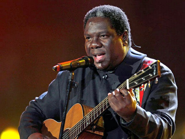 World Cup 2010 Kick-off Concert Vusi Mahlasela - Vusi Mahlasela a musician from South Africa performs on stage during the Kick-off Concert for the FIFA World Cup 2010 at the Orlando stadium in Soweto, Johannesburg, South Africa (June 10, 2010). - , World, Cup, 2010, Kick-off, concert, concerts, Vusi, Mahlasela, music, musics, performance, performances, party, parties, show, shows, celebration, celebrations, sport, sports, tournament, tournaments, musician, musicians, stage, stages, FIFA, Orlando, stadium, stadiums, Soweto, Johannesburg, South, Africa - Vusi Mahlasela a musician from South Africa performs on stage during the Kick-off Concert for the FIFA World Cup 2010 at the Orlando stadium in Soweto, Johannesburg, South Africa (June 10, 2010). Solve free online World Cup 2010 Kick-off Concert Vusi Mahlasela puzzle games or send World Cup 2010 Kick-off Concert Vusi Mahlasela puzzle game greeting ecards  from puzzles-games.eu.. World Cup 2010 Kick-off Concert Vusi Mahlasela puzzle, puzzles, puzzles games, puzzles-games.eu, puzzle games, online puzzle games, free puzzle games, free online puzzle games, World Cup 2010 Kick-off Concert Vusi Mahlasela free puzzle game, World Cup 2010 Kick-off Concert Vusi Mahlasela online puzzle game, jigsaw puzzles, World Cup 2010 Kick-off Concert Vusi Mahlasela jigsaw puzzle, jigsaw puzzle games, jigsaw puzzles games, World Cup 2010 Kick-off Concert Vusi Mahlasela puzzle game ecard, puzzles games ecards, World Cup 2010 Kick-off Concert Vusi Mahlasela puzzle game greeting ecard