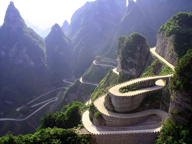 Avenue Towards Heaven Tianmen Mountain National Park Zhangjiajie Hunan China Wallpaper - Wallpaper with the scenic area of the 'Avenue Towards Heaven' (known as the Big Gate Road), one of the scariest road in the world, which is located within the Tianmen Mountain National Park, Zhangjiajie, in northwestern Hunan Province of China. The 'Avenue Towards Heaven', also called 'the road of the 99 turns', is a wonderful road that rises from 200 m to 1300 м above the sea level the Tianmen mountain, very near to the top. Its building was started in 1998 and was completed eight years later. - , avenue, avenues, Heaven, Tianmen, Mountain, mountains, National, Park, parks, Zhangjiajie, Hunan, China, wallpaper, wallpapers, nature, natures, places, place, travel, travels, tour, tours, trip, trips, scenic, area, areas, Big, Gate, gates, Road, roads, scariest, world, worlds, northwestern, province, provinces, road, roads, turns, turn, wonderful, sea, level, levels, top, tops, 1998, years, year - Wallpaper with the scenic area of the 'Avenue Towards Heaven' (known as the Big Gate Road), one of the scariest road in the world, which is located within the Tianmen Mountain National Park, Zhangjiajie, in northwestern Hunan Province of China. The 'Avenue Towards Heaven', also called 'the road of the 99 turns', is a wonderful road that rises from 200 m to 1300 м above the sea level the Tianmen mountain, very near to the top. Its building was started in 1998 and was completed eight years later. Solve free online Avenue Towards Heaven Tianmen Mountain National Park Zhangjiajie Hunan China Wallpaper puzzle games or send Avenue Towards Heaven Tianmen Mountain National Park Zhangjiajie Hunan China Wallpaper puzzle game greeting ecards  from puzzles-games.eu.. Avenue Towards Heaven Tianmen Mountain National Park Zhangjiajie Hunan China Wallpaper puzzle, puzzles, puzzles games, puzzles-games.eu, puzzle games, online puzzle games, free puzzle games, free online puzzle games, Avenue Towards Heaven Tianmen Mountain National Park Zhangjiajie Hunan China Wallpaper free puzzle game, Avenue Towards Heaven Tianmen Mountain National Park Zhangjiajie Hunan China Wallpaper online puzzle game, jigsaw puzzles, Avenue Towards Heaven Tianmen Mountain National Park Zhangjiajie Hunan China Wallpaper jigsaw puzzle, jigsaw puzzle games, jigsaw puzzles games, Avenue Towards Heaven Tianmen Mountain National Park Zhangjiajie Hunan China Wallpaper puzzle game ecard, puzzles games ecards, Avenue Towards Heaven Tianmen Mountain National Park Zhangjiajie Hunan China Wallpaper puzzle game greeting ecard
