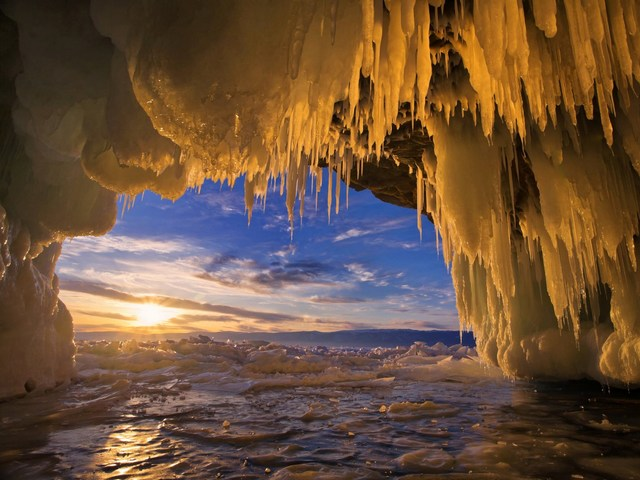 Baikal Ice Cave Landscape Russia - Beautiful landscape with sunset, viewed through sparkling stalactites from inside an ice cave on Olkhon Island in Lake Baikal, Russia. <br /> The lake Baikal is located in the south of the Russian region of Siberia, between Irkutsk Oblast and the Buryat Republic, near the Mongolian border. It is the oldest (at 25 million years), deepest (with a maximum depth of 1,642 m) and clearest freshwater lake in the world. The lake Baikal, with its 23,615.39 km3, is the most voluminous freshwater lake, containing roughly 20% of the world's unfrozen fresh water.<br /> In winter, the lake Baikal is transformеd to the realm of the great ice and mighty winds, which lead to fascinating phenomena building beautiful and incredible ice formations. - , Baikal, ice, cave, caves, landscape, landscapes, Russia, naure, natures, sunset, stalactite, stalactite, cave, caves, Olkhon, island, lake, lakes, Russian, region, regions, Siberia, Irkutsk, oblast, Buryat, republic, republics, Mongolian, border, borders, freshwater, freshwaters, unfrozen, fresh, water, winter, realm, ice, ices, mighty, winds, wind, which, lead, to, fascinating, phenomena, incredible, formations, formation - Beautiful landscape with sunset, viewed through sparkling stalactites from inside an ice cave on Olkhon Island in Lake Baikal, Russia. <br /> The lake Baikal is located in the south of the Russian region of Siberia, between Irkutsk Oblast and the Buryat Republic, near the Mongolian border. It is the oldest (at 25 million years), deepest (with a maximum depth of 1,642 m) and clearest freshwater lake in the world. The lake Baikal, with its 23,615.39 km3, is the most voluminous freshwater lake, containing roughly 20% of the world's unfrozen fresh water.<br /> In winter, the lake Baikal is transformеd to the realm of the great ice and mighty winds, which lead to fascinating phenomena building beautiful and incredible ice formations. Solve free online Baikal Ice Cave Landscape Russia puzzle games or send Baikal Ice Cave Landscape Russia puzzle game greeting ecards  from puzzles-games.eu.. Baikal Ice Cave Landscape Russia puzzle, puzzles, puzzles games, puzzles-games.eu, puzzle games, online puzzle games, free puzzle games, free online puzzle games, Baikal Ice Cave Landscape Russia free puzzle game, Baikal Ice Cave Landscape Russia online puzzle game, jigsaw puzzles, Baikal Ice Cave Landscape Russia jigsaw puzzle, jigsaw puzzle games, jigsaw puzzles games, Baikal Ice Cave Landscape Russia puzzle game ecard, puzzles games ecards, Baikal Ice Cave Landscape Russia puzzle game greeting ecard