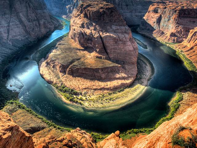 Horseshoe Bend on Colorado River Arizona - Fantastic view from the steep cliff above the 'Horseshoe Bend', an impressive meander with horse-shoe shape, which the emerald-green Colorado river forms in the ancient sandstone of Arizona, while makes a giant 270 degree u-turn around a massive rock. Horseshoe Bend is located in the Southwest America, near the Lake Powell, on the border between Utah and Arizona, at Glen Canyon National Recreation Area, a popular summer destination. - , Horseshoe, horseshoes, Bend, bends, Colorado, river, rivers, Arizona, nature, natures, places, place, travel, travels, tour, tours, trip, trips, fantastic, view, views, steep, cliff, cliffs, impressive, meander, meanders, shape, shapes, emerald, green, ancient, sandstone, sandstones, giant, degree, degrees, turn, turns, massive, rock, rocks, Southwest, America, lake, lakes, Powell, border, borders, Utah, Glen, canyon, canyons, national, recreation, area, areas, popular, summer, destination, destinations - Fantastic view from the steep cliff above the 'Horseshoe Bend', an impressive meander with horse-shoe shape, which the emerald-green Colorado river forms in the ancient sandstone of Arizona, while makes a giant 270 degree u-turn around a massive rock. Horseshoe Bend is located in the Southwest America, near the Lake Powell, on the border between Utah and Arizona, at Glen Canyon National Recreation Area, a popular summer destination. Solve free online Horseshoe Bend on Colorado River Arizona puzzle games or send Horseshoe Bend on Colorado River Arizona puzzle game greeting ecards  from puzzles-games.eu.. Horseshoe Bend on Colorado River Arizona puzzle, puzzles, puzzles games, puzzles-games.eu, puzzle games, online puzzle games, free puzzle games, free online puzzle games, Horseshoe Bend on Colorado River Arizona free puzzle game, Horseshoe Bend on Colorado River Arizona online puzzle game, jigsaw puzzles, Horseshoe Bend on Colorado River Arizona jigsaw puzzle, jigsaw puzzle games, jigsaw puzzles games, Horseshoe Bend on Colorado River Arizona puzzle game ecard, puzzles games ecards, Horseshoe Bend on Colorado River Arizona puzzle game greeting ecard