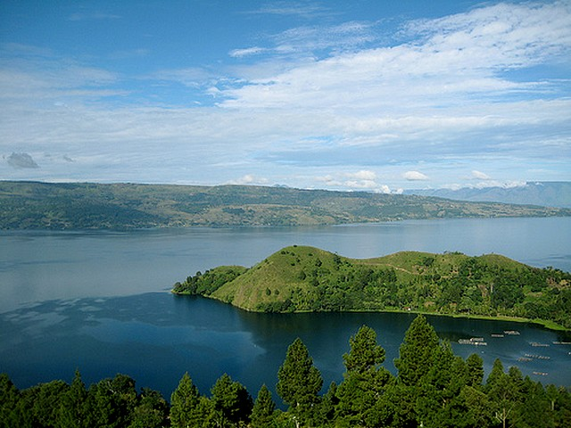 Volcano Indonesia Lake Toba North Sumatra - Lake Toba at North Sumatra, Indonesia, is the largest volcanic lake in the world, a supervolcano - 100 km long, 30 km wide and 505 m deep, whose eruption 74,000 years ago induce six years of volcanic winter, which caused environmental changes and extinction of some human species. - , volcano, volcanoes, Indonesia, Lake, Toba, North, Sumatra, nature, natures, largest, volcanic, lakes, world, worlds, supervolcano, long, wide, deep, eruption, eruptions, years, year, winter, winters, environmental, changes, change, extinctions, extinction, human, species, specie - Lake Toba at North Sumatra, Indonesia, is the largest volcanic lake in the world, a supervolcano - 100 km long, 30 km wide and 505 m deep, whose eruption 74,000 years ago induce six years of volcanic winter, which caused environmental changes and extinction of some human species. Solve free online Volcano Indonesia Lake Toba North Sumatra puzzle games or send Volcano Indonesia Lake Toba North Sumatra puzzle game greeting ecards  from puzzles-games.eu.. Volcano Indonesia Lake Toba North Sumatra puzzle, puzzles, puzzles games, puzzles-games.eu, puzzle games, online puzzle games, free puzzle games, free online puzzle games, Volcano Indonesia Lake Toba North Sumatra free puzzle game, Volcano Indonesia Lake Toba North Sumatra online puzzle game, jigsaw puzzles, Volcano Indonesia Lake Toba North Sumatra jigsaw puzzle, jigsaw puzzle games, jigsaw puzzles games, Volcano Indonesia Lake Toba North Sumatra puzzle game ecard, puzzles games ecards, Volcano Indonesia Lake Toba North Sumatra puzzle game greeting ecard