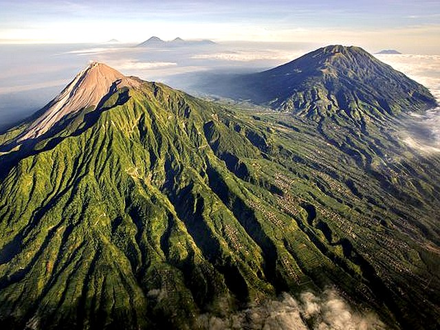 Volcano Indonesia Mount Merapi Aerial View - An aerial view on Mount Merapi with one of the most active of 69 volcanoes in Indonesia, which lies in a very densely populated area, near the Yogyakarta in a region known as the 'Pacific Ring of Fire'. - , volcano, volcanoes, Indonesia, Mount, Merapi, aerial, view, views, nature, natures, active, densely, populated, area, areas, Yogyakarta, region, regions, known, Pacific, Ring, Fire, rings, fires - An aerial view on Mount Merapi with one of the most active of 69 volcanoes in Indonesia, which lies in a very densely populated area, near the Yogyakarta in a region known as the 'Pacific Ring of Fire'. Solve free online Volcano Indonesia Mount Merapi Aerial View puzzle games or send Volcano Indonesia Mount Merapi Aerial View puzzle game greeting ecards  from puzzles-games.eu.. Volcano Indonesia Mount Merapi Aerial View puzzle, puzzles, puzzles games, puzzles-games.eu, puzzle games, online puzzle games, free puzzle games, free online puzzle games, Volcano Indonesia Mount Merapi Aerial View free puzzle game, Volcano Indonesia Mount Merapi Aerial View online puzzle game, jigsaw puzzles, Volcano Indonesia Mount Merapi Aerial View jigsaw puzzle, jigsaw puzzle games, jigsaw puzzles games, Volcano Indonesia Mount Merapi Aerial View puzzle game ecard, puzzles games ecards, Volcano Indonesia Mount Merapi Aerial View puzzle game greeting ecard