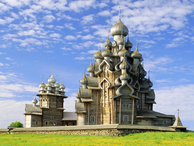 Church of the Transfiguration Kizhi Island Karelia Russia - The Church of the Transfiguration is the most remarkable part of the Kizhi Pogost, a historical site from the 17th century, located on the Kizhi island in the Lake Onega, the Republic of Karelia, Russia. Kizhi Pogost includes two large wooden churches, Transfiguration Church with 22 domes, which is one of the tallest wooden buildings of the Russian North with height of 37 meters, Intercession Church with 9 domes and a bell tower. The pogost is built exclusively of wood, with logs of Scots Pine (Pinus sylvestris) about 30 cm in diameter and 3 to 5 meters long, without using a single nail. - , church, churches, Transfiguration, Kizhi, island, islands, Karelia, Russia, places, place, nature, natures, remarkable, part, parts, Pogost, historical, site, sites, 17th, century, centuries, Lake, lakes, Onega, Republic, wooden, domes, dome, buildings, building, Russian, North, height, Intercession, bell, bells, tower, towers, wood, logs, log - The Church of the Transfiguration is the most remarkable part of the Kizhi Pogost, a historical site from the 17th century, located on the Kizhi island in the Lake Onega, the Republic of Karelia, Russia. Kizhi Pogost includes two large wooden churches, Transfiguration Church with 22 domes, which is one of the tallest wooden buildings of the Russian North with height of 37 meters, Intercession Church with 9 domes and a bell tower. The pogost is built exclusively of wood, with logs of Scots Pine (Pinus sylvestris) about 30 cm in diameter and 3 to 5 meters long, without using a single nail. Solve free online Church of the Transfiguration Kizhi Island Karelia Russia puzzle games or send Church of the Transfiguration Kizhi Island Karelia Russia puzzle game greeting ecards  from puzzles-games.eu.. Church of the Transfiguration Kizhi Island Karelia Russia puzzle, puzzles, puzzles games, puzzles-games.eu, puzzle games, online puzzle games, free puzzle games, free online puzzle games, Church of the Transfiguration Kizhi Island Karelia Russia free puzzle game, Church of the Transfiguration Kizhi Island Karelia Russia online puzzle game, jigsaw puzzles, Church of the Transfiguration Kizhi Island Karelia Russia jigsaw puzzle, jigsaw puzzle games, jigsaw puzzles games, Church of the Transfiguration Kizhi Island Karelia Russia puzzle game ecard, puzzles games ecards, Church of the Transfiguration Kizhi Island Karelia Russia puzzle game greeting ecard