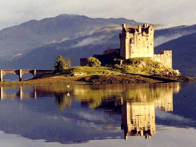 Eilean Donan Castle Scotland UK - Eilean Donan Castle with its enchantingly beautiful reflection in the water at dusk, surrounded by majestic scenery, is one of the most iconic landmarks in UK and in the world. The castle was built in the 13th century (1220), on a small island in Loch Duich in western highlands of Scotland, for defence against Vikings. The castle was named after Bishop Donan who arrived in the country in the 6th century. After it has been rebuilt several times, since 1932 the Eilean Donan Castle was re-opened to public. - , Eilean, Donan, castle, castles, Scotland, UK, places, place, travel, travels, tour, tours, trip, trips, enchantingly, beautiful, reflection, reflections, water, waters, dusk, majestic, scenery, sceneries, iconic, attractions, landmark, landmarks, world, 13th, century, centuries, 1220, island, islands, Loch, Duich, western, highlands, highland, defence, defences, Vikings, bishop, bishops, Donan, country, countries, 1932, public - Eilean Donan Castle with its enchantingly beautiful reflection in the water at dusk, surrounded by majestic scenery, is one of the most iconic landmarks in UK and in the world. The castle was built in the 13th century (1220), on a small island in Loch Duich in western highlands of Scotland, for defence against Vikings. The castle was named after Bishop Donan who arrived in the country in the 6th century. After it has been rebuilt several times, since 1932 the Eilean Donan Castle was re-opened to public. Solve free online Eilean Donan Castle Scotland UK puzzle games or send Eilean Donan Castle Scotland UK puzzle game greeting ecards  from puzzles-games.eu.. Eilean Donan Castle Scotland UK puzzle, puzzles, puzzles games, puzzles-games.eu, puzzle games, online puzzle games, free puzzle games, free online puzzle games, Eilean Donan Castle Scotland UK free puzzle game, Eilean Donan Castle Scotland UK online puzzle game, jigsaw puzzles, Eilean Donan Castle Scotland UK jigsaw puzzle, jigsaw puzzle games, jigsaw puzzles games, Eilean Donan Castle Scotland UK puzzle game ecard, puzzles games ecards, Eilean Donan Castle Scotland UK puzzle game greeting ecard