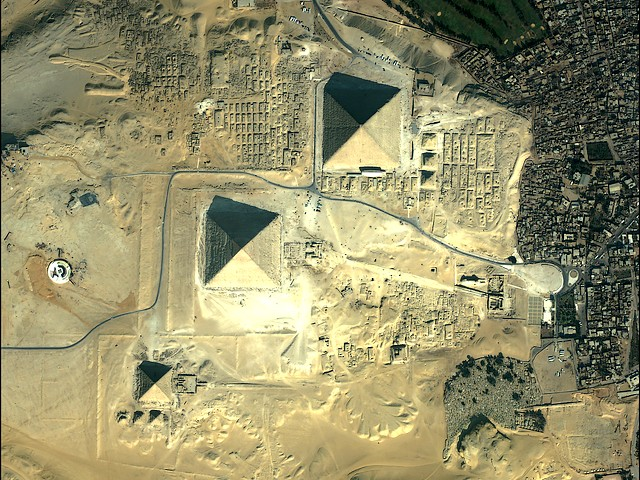 Great Pyramids of Giza Cairo Egypt Image by QuickBird Satellite Sensor - An image of the complex of ancient monuments with the Great Pyramids and the accompanying structures on the plateau of Giza, in the outskirts of Cairo, Egypt, made by the QuickBird Satellite sensor. If it is compared the location of the three Great Pyramids (of Cheops, Khafre and Menkaures), with the stars of Orion's belt in the night sky, it is seen that they are reflecting this celestial phenomenon. - , great, pyramids, pyramid, Giza, Cairo, Egypt, image, images, QuickBird, satellite, satellites, sensor, sensors, places, place, travel, travels, tour, tours, trip, trips, complex, complexes, ancient, monuments, monument, accompanying, structures, structure, plateau, plateaus, outskirts, outskirt, location, locations, Cheops, Khafre, Menkaure, stars, star, Orion, belt, belts, night, sky, skies, celestial, phenomenon, phenomena - An image of the complex of ancient monuments with the Great Pyramids and the accompanying structures on the plateau of Giza, in the outskirts of Cairo, Egypt, made by the QuickBird Satellite sensor. If it is compared the location of the three Great Pyramids (of Cheops, Khafre and Menkaures), with the stars of Orion's belt in the night sky, it is seen that they are reflecting this celestial phenomenon. Solve free online Great Pyramids of Giza Cairo Egypt Image by QuickBird Satellite Sensor puzzle games or send Great Pyramids of Giza Cairo Egypt Image by QuickBird Satellite Sensor puzzle game greeting ecards  from puzzles-games.eu.. Great Pyramids of Giza Cairo Egypt Image by QuickBird Satellite Sensor puzzle, puzzles, puzzles games, puzzles-games.eu, puzzle games, online puzzle games, free puzzle games, free online puzzle games, Great Pyramids of Giza Cairo Egypt Image by QuickBird Satellite Sensor free puzzle game, Great Pyramids of Giza Cairo Egypt Image by QuickBird Satellite Sensor online puzzle game, jigsaw puzzles, Great Pyramids of Giza Cairo Egypt Image by QuickBird Satellite Sensor jigsaw puzzle, jigsaw puzzle games, jigsaw puzzles games, Great Pyramids of Giza Cairo Egypt Image by QuickBird Satellite Sensor puzzle game ecard, puzzles games ecards, Great Pyramids of Giza Cairo Egypt Image by QuickBird Satellite Sensor puzzle game greeting ecard