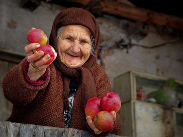 Hospitality in Rhodope Mountains Bulgaria - Beautiful photo of an old, wrinkled woman with a charming toothless smile, who offers generously apples and hospitality among an unique and memorable with serenity scenery of the Rhodope Mountains in Bulgaria. - , hospitality, Rhodope, Mountains, mountain, Bulgaria, places, place, nature, natures, travel, tour, beautiful, photo, photos, old, wrinkled, woman, women, charming, toothless, smile, smiles, generously, apples, apple, unique, memorable, serenity, scenery, sceneries - Beautiful photo of an old, wrinkled woman with a charming toothless smile, who offers generously apples and hospitality among an unique and memorable with serenity scenery of the Rhodope Mountains in Bulgaria. Solve free online Hospitality in Rhodope Mountains Bulgaria puzzle games or send Hospitality in Rhodope Mountains Bulgaria puzzle game greeting ecards  from puzzles-games.eu.. Hospitality in Rhodope Mountains Bulgaria puzzle, puzzles, puzzles games, puzzles-games.eu, puzzle games, online puzzle games, free puzzle games, free online puzzle games, Hospitality in Rhodope Mountains Bulgaria free puzzle game, Hospitality in Rhodope Mountains Bulgaria online puzzle game, jigsaw puzzles, Hospitality in Rhodope Mountains Bulgaria jigsaw puzzle, jigsaw puzzle games, jigsaw puzzles games, Hospitality in Rhodope Mountains Bulgaria puzzle game ecard, puzzles games ecards, Hospitality in Rhodope Mountains Bulgaria puzzle game greeting ecard
