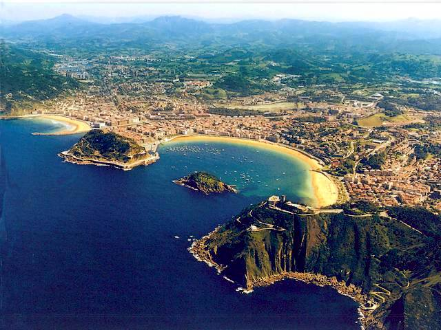 San Sebastian Seaside Resort in Spain Aerial Photo - An aerial photo of San Sebastian (Donostia), a fashionable and luxurious seaside resort, which lies on the Bay of Biscay near the French frontier, on the northwest Atlantic coast of Spain in Basque country. The bay of La Concha in shape of a mussel's shell  with little island as pearl in the middle, the lovely stretches with golden beaches and the two-mile-long promenade, are the pride of San Sebastian. It was a favorite spa resort of European royalty in the 19th century and nowadays, entire Spanish government has a holiday in San Sebastian in July and August. - , San, Sebastian, seaside, resort, resorts, Spain, aerial, photo, photos, places, place, travel, travels, tour, tours, trip, trips, Donostia, fashionable, luxurious, bay, bays, Biscay, French, frontier, frontiers, northwest, Atlantic, coast, coasts, Basque, country, countries, LaConcha, Concha, shape, shapes, mussel, mussels, shell, shells, island, islands, pearl, pearls, lovely, stretches, stretch, golden, beaches, beach, promenade, promenades, pride, prides, favorite, spa, European, royalty, 19th, century, centuries, Spanish, government, governments, holiday, holidays, July, August - An aerial photo of San Sebastian (Donostia), a fashionable and luxurious seaside resort, which lies on the Bay of Biscay near the French frontier, on the northwest Atlantic coast of Spain in Basque country. The bay of La Concha in shape of a mussel's shell  with little island as pearl in the middle, the lovely stretches with golden beaches and the two-mile-long promenade, are the pride of San Sebastian. It was a favorite spa resort of European royalty in the 19th century and nowadays, entire Spanish government has a holiday in San Sebastian in July and August. Solve free online San Sebastian Seaside Resort in Spain Aerial Photo puzzle games or send San Sebastian Seaside Resort in Spain Aerial Photo puzzle game greeting ecards  from puzzles-games.eu.. San Sebastian Seaside Resort in Spain Aerial Photo puzzle, puzzles, puzzles games, puzzles-games.eu, puzzle games, online puzzle games, free puzzle games, free online puzzle games, San Sebastian Seaside Resort in Spain Aerial Photo free puzzle game, San Sebastian Seaside Resort in Spain Aerial Photo online puzzle game, jigsaw puzzles, San Sebastian Seaside Resort in Spain Aerial Photo jigsaw puzzle, jigsaw puzzle games, jigsaw puzzles games, San Sebastian Seaside Resort in Spain Aerial Photo puzzle game ecard, puzzles games ecards, San Sebastian Seaside Resort in Spain Aerial Photo puzzle game greeting ecard