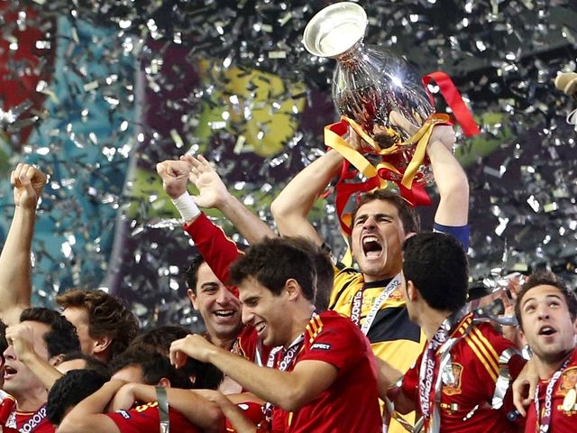 Euro 2012 Final Iker Casillas with Trophy - Spain goalkeeper Iker Casillas with the trophy after the soccer championship final Euro 2012 between Spain and Italy in Kiev, Ukraine (July 1, 2012), when  Spain won the match with score 4-0. Spain is the first European team in history with a hat-trick of titles after winning Euro 2008 and the World Cup 2010. - , Euro, 2012, final, finals, Iker, Casillas, trophy, trophies, sport, sports, tournament, tournaments, football, footballs, Spain, goalkeeper, goalkeepers, soccer, championship, championships, Italy, Kiev, Ukraine, July, 2012, match, matches, score, scores, European, team, teams, histories, history, hat-trick, titles, title, 2008, World, Cup, 2010 - Spain goalkeeper Iker Casillas with the trophy after the soccer championship final Euro 2012 between Spain and Italy in Kiev, Ukraine (July 1, 2012), when  Spain won the match with score 4-0. Spain is the first European team in history with a hat-trick of titles after winning Euro 2008 and the World Cup 2010. Solve free online Euro 2012 Final Iker Casillas with Trophy puzzle games or send Euro 2012 Final Iker Casillas with Trophy puzzle game greeting ecards  from puzzles-games.eu.. Euro 2012 Final Iker Casillas with Trophy puzzle, puzzles, puzzles games, puzzles-games.eu, puzzle games, online puzzle games, free puzzle games, free online puzzle games, Euro 2012 Final Iker Casillas with Trophy free puzzle game, Euro 2012 Final Iker Casillas with Trophy online puzzle game, jigsaw puzzles, Euro 2012 Final Iker Casillas with Trophy jigsaw puzzle, jigsaw puzzle games, jigsaw puzzles games, Euro 2012 Final Iker Casillas with Trophy puzzle game ecard, puzzles games ecards, Euro 2012 Final Iker Casillas with Trophy puzzle game greeting ecard