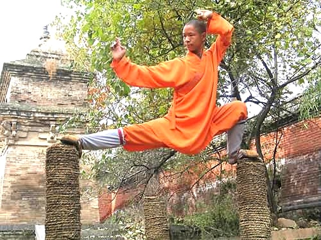 Kung fu - Student at the Shaolin Temple demonstrating Kung fu position on top of Kungfu poles. - , Kung, fu, sport, sports, student, students, Shaolin, Temple, temples, position, positions, top, tops, Kungfu, poles, pole - Student at the Shaolin Temple demonstrating Kung fu position on top of Kungfu poles. Solve free online Kung fu puzzle games or send Kung fu puzzle game greeting ecards  from puzzles-games.eu.. Kung fu puzzle, puzzles, puzzles games, puzzles-games.eu, puzzle games, online puzzle games, free puzzle games, free online puzzle games, Kung fu free puzzle game, Kung fu online puzzle game, jigsaw puzzles, Kung fu jigsaw puzzle, jigsaw puzzle games, jigsaw puzzles games, Kung fu puzzle game ecard, puzzles games ecards, Kung fu puzzle game greeting ecard