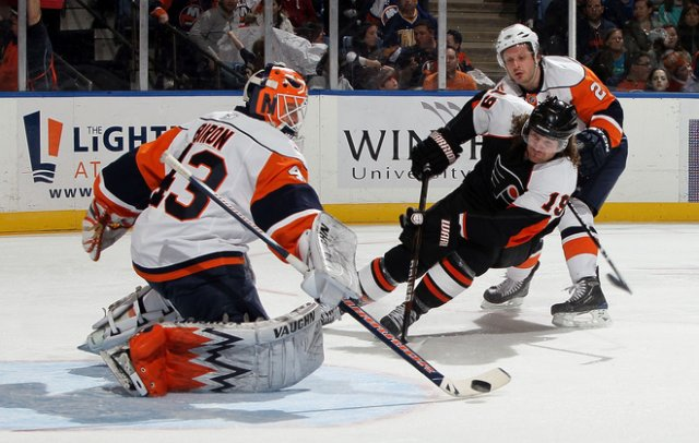 NHL 2010 Scott Hartnell in off-side - Scott Hartnell #19 of the Philadelphia Flyers in off-side by Martin Biron #42 and Mark Steit #2 of the New York Islanders during the NHL 2010 in Uniondale, New York (April 01). - , NHL, 2010, Scott, Hartnell, off-side, sport, sports, hockey, ice-hockey, Philadelphia, Flyers, Martin, Biron, Mark, Steit, New, York, Islanders, Uniondale - Scott Hartnell #19 of the Philadelphia Flyers in off-side by Martin Biron #42 and Mark Steit #2 of the New York Islanders during the NHL 2010 in Uniondale, New York (April 01). Solve free online NHL 2010 Scott Hartnell in off-side puzzle games or send NHL 2010 Scott Hartnell in off-side puzzle game greeting ecards  from puzzles-games.eu.. NHL 2010 Scott Hartnell in off-side puzzle, puzzles, puzzles games, puzzles-games.eu, puzzle games, online puzzle games, free puzzle games, free online puzzle games, NHL 2010 Scott Hartnell in off-side free puzzle game, NHL 2010 Scott Hartnell in off-side online puzzle game, jigsaw puzzles, NHL 2010 Scott Hartnell in off-side jigsaw puzzle, jigsaw puzzle games, jigsaw puzzles games, NHL 2010 Scott Hartnell in off-side puzzle game ecard, puzzles games ecards, NHL 2010 Scott Hartnell in off-side puzzle game greeting ecard