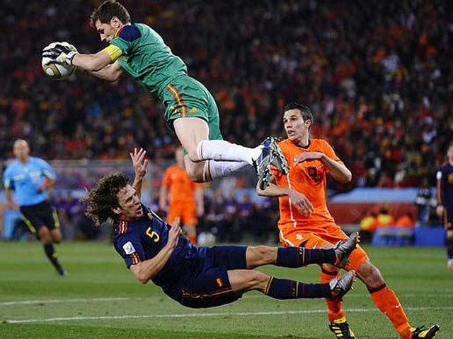 World Cup 2010 Champion Iker Casillas makes a Save - The Spain's goalkeeper Iker Casillas makes a save above the Netherlands' striker Robin van Persie and collides with the team-mate Carles Puyol as he gathers the ball during the FIFA World Cup 2010 Champion Final at the Soccer City stadium in Johannesburg, South Africa (July 11, 2020). - , World, Cup, 2010, Champion, Iker, Casillas, save, saves, sport, sports, tournament, tournaments, match, matches, soccer, soccers, football, footballs, Spain, goalkeeper, goalkeepers, Netherlands, striker, strikers, Robin, van, Persie, team-mate, Carles, Puyol, ball, balls, FIFA, Final, finals, Soccer, City, stadium, stadiums, Johannesburg, South, Africa - The Spain's goalkeeper Iker Casillas makes a save above the Netherlands' striker Robin van Persie and collides with the team-mate Carles Puyol as he gathers the ball during the FIFA World Cup 2010 Champion Final at the Soccer City stadium in Johannesburg, South Africa (July 11, 2020). Solve free online World Cup 2010 Champion Iker Casillas makes a Save puzzle games or send World Cup 2010 Champion Iker Casillas makes a Save puzzle game greeting ecards  from puzzles-games.eu.. World Cup 2010 Champion Iker Casillas makes a Save puzzle, puzzles, puzzles games, puzzles-games.eu, puzzle games, online puzzle games, free puzzle games, free online puzzle games, World Cup 2010 Champion Iker Casillas makes a Save free puzzle game, World Cup 2010 Champion Iker Casillas makes a Save online puzzle game, jigsaw puzzles, World Cup 2010 Champion Iker Casillas makes a Save jigsaw puzzle, jigsaw puzzle games, jigsaw puzzles games, World Cup 2010 Champion Iker Casillas makes a Save puzzle game ecard, puzzles games ecards, World Cup 2010 Champion Iker Casillas makes a Save puzzle game greeting ecard
