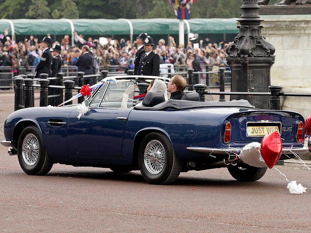 Royal Wedding England Newlyweds in Aston Martin Volante on Bioethanol Fuel to Clarence House London - Newlyweds, Prince William, Duke of Cambridge and his wife Catherine, Duchess of Cambridge, on the way to Clarence House in Aston Martin DB6 MKII Volante, after ceremony of the royal wedding, on April 29, 2011 in London, England. The car is a gift from the Queen for 21st birthday of Prince Charles in 1969, which has been reworked to run on bioethanol fuel, distilled from surplus British wine. - , Royal, wedding, weddings, England, newlyweds, newlywed, Aston, Martin, Volante, bioethanol, fuel, fuels, Clarence, House, houses, London, autos, auto, car, cars, automobiles, automobile, show, shows, celebrities, celebrity, ceremony, ceremonies, event, events, entertainment, entertainments, place, places, travel, travels, tour, tours, prince, princes, William, duke, dukes, Cambridge, wife, wifes, Catherine, duchess, duchesses, DB6, MKII, April, 2011, England, gift, gifts, Queen, queens, birthday, birthdays, Charles, 1969, surplus, surpluses, British, wine, wines - Newlyweds, Prince William, Duke of Cambridge and his wife Catherine, Duchess of Cambridge, on the way to Clarence House in Aston Martin DB6 MKII Volante, after ceremony of the royal wedding, on April 29, 2011 in London, England. The car is a gift from the Queen for 21st birthday of Prince Charles in 1969, which has been reworked to run on bioethanol fuel, distilled from surplus British wine. Solve free online Royal Wedding England Newlyweds in Aston Martin Volante on Bioethanol Fuel to Clarence House London puzzle games or send Royal Wedding England Newlyweds in Aston Martin Volante on Bioethanol Fuel to Clarence House London puzzle game greeting ecards  from puzzles-games.eu.. Royal Wedding England Newlyweds in Aston Martin Volante on Bioethanol Fuel to Clarence House London puzzle, puzzles, puzzles games, puzzles-games.eu, puzzle games, online puzzle games, free puzzle games, free online puzzle games, Royal Wedding England Newlyweds in Aston Martin Volante on Bioethanol Fuel to Clarence House London free puzzle game, Royal Wedding England Newlyweds in Aston Martin Volante on Bioethanol Fuel to Clarence House London online puzzle game, jigsaw puzzles, Royal Wedding England Newlyweds in Aston Martin Volante on Bioethanol Fuel to Clarence House London jigsaw puzzle, jigsaw puzzle games, jigsaw puzzles games, Royal Wedding England Newlyweds in Aston Martin Volante on Bioethanol Fuel to Clarence House London puzzle game ecard, puzzles games ecards, Royal Wedding England Newlyweds in Aston Martin Volante on Bioethanol Fuel to Clarence House London puzzle game greeting ecard