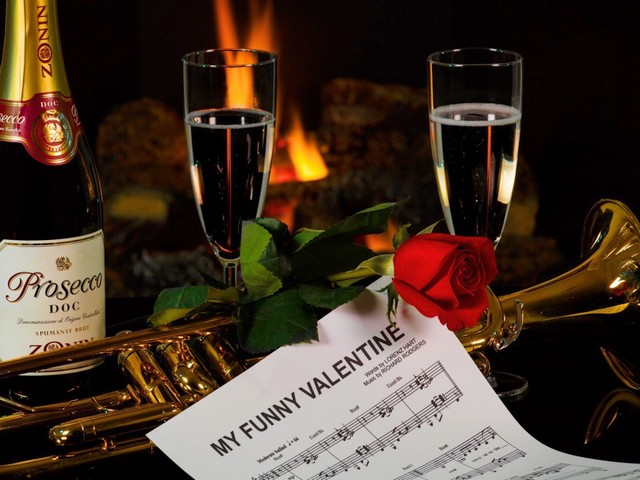 Valentines Day Romantic Music and Wine Wallpaper - Wallpaper for Valentines Day, depicting a musical score of 'My Funny Valentine' and bottle of Prosecco DOC Spumante, on background of burning fireplace, for the lovers of romantic music and an Italian white wine. <br /> Prosecco DOC Spumante is a popular sparkling wine, made from Glera grapes, using the Charmat-Martinotti method, in which the secondary fermentation takes place in stainless steel tanks, making the wine a less expensive substitute for the Champagne.<br /> 'My Funny Valentine' is a show tune from the 1937, by the American composer Richard Rodgers (1902-1979) and the lyricists Lorenz Hart (1895-1943) and Oscar Hammerstein II, which became a popular classic jazz standard , appearing on over 1300 albums, recorded by over 600 performers, as  Frank Sinatra (1954), Chet Baker (1955), Ella Fitzgerald (1956), Miles Davis (1964), Chris Botti (2003). - , Valentines, Day, romantic, music, wine, wallpaper, wallpapers, cartoon, cartoons, holiday, holidays, feast, musical, score, scores, funny, Valentine, bottle, bottles, Prosecco, Spumante, background, backgrounds, fireplace, fireplaces, lovers, lover, Italian, white, popular, sparkling, Glera, grapes, grape, Charmat, Martinotti, method, methods, fermentation, stainless, steel, tanks, tank, expensive, substitute, Champagne, show, tune, tunes, 1937, American, composer, composers, Richard, Rodgers, 1902, 1979, lyricists, lyricist, Lorenz, Hart, 1895, 1943, Oscar, Hammerstein, popular, classic, jazz, standard, albums, album, performers, performer, Frank, Sinatra, 1954, Chet, Baker, 1955, Ella, Fitzgerald, 1956, Miles, Davis, 1964, Chris, Botti, 2003 - Wallpaper for Valentines Day, depicting a musical score of 'My Funny Valentine' and bottle of Prosecco DOC Spumante, on background of burning fireplace, for the lovers of romantic music and an Italian white wine. <br /> Prosecco DOC Spumante is a popular sparkling wine, made from Glera grapes, using the Charmat-Martinotti method, in which the secondary fermentation takes place in stainless steel tanks, making the wine a less expensive substitute for the Champagne.<br /> 'My Funny Valentine' is a show tune from the 1937, by the American composer Richard Rodgers (1902-1979) and the lyricists Lorenz Hart (1895-1943) and Oscar Hammerstein II, which became a popular classic jazz standard , appearing on over 1300 albums, recorded by over 600 performers, as  Frank Sinatra (1954), Chet Baker (1955), Ella Fitzgerald (1956), Miles Davis (1964), Chris Botti (2003). Solve free online Valentines Day Romantic Music and Wine Wallpaper puzzle games or send Valentines Day Romantic Music and Wine Wallpaper puzzle game greeting ecards  from puzzles-games.eu.. Valentines Day Romantic Music and Wine Wallpaper puzzle, puzzles, puzzles games, puzzles-games.eu, puzzle games, online puzzle games, free puzzle games, free online puzzle games, Valentines Day Romantic Music and Wine Wallpaper free puzzle game, Valentines Day Romantic Music and Wine Wallpaper online puzzle game, jigsaw puzzles, Valentines Day Romantic Music and Wine Wallpaper jigsaw puzzle, jigsaw puzzle games, jigsaw puzzles games, Valentines Day Romantic Music and Wine Wallpaper puzzle game ecard, puzzles games ecards, Valentines Day Romantic Music and Wine Wallpaper puzzle game greeting ecard