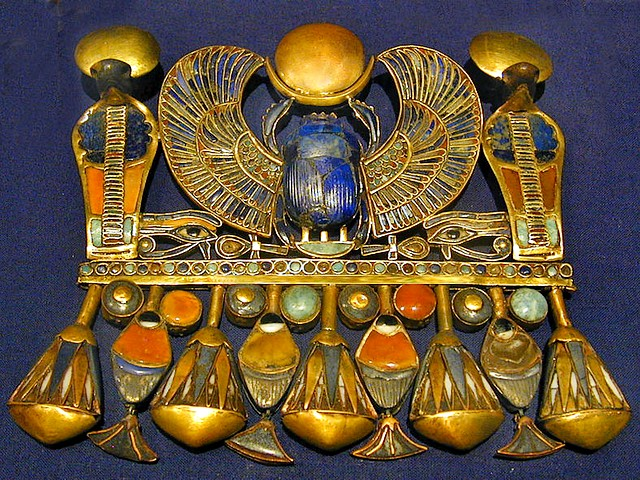 Tutankhamun Winged Scarab Pectoral in Melbourne Museum Australia - Pectoral adornment in shape of winged scarab with semi-precious stones, one of the most admired jewelry, discovered in the tomb of the Egyptian pharaoh Tutankhamun, displayed in the Melbourne Museum during the exhibition 'Tutankhamun and the Golden Age of the Pharaohs', as a part of the '2011 Melbourne Winter Masterpieces' (April 8 to November 6, 2011). - , Tutankhamun, winged, scarab, scarabs, pectoral, pectorals, Melbourne, museum, museums, Australia, art, arts, places, place, travel, travels, trip, trips, tour, tours, adornment, adornments, shape, shapes, semi-precious, stones, stone, jewelry, jewel, tomb, tombs, Egyptian, pharaoh, pharaohs, exhibition, exhibitions, golden, age, ages, part, parts, 2011, winter, masterpieces, masterpiece, April, November - Pectoral adornment in shape of winged scarab with semi-precious stones, one of the most admired jewelry, discovered in the tomb of the Egyptian pharaoh Tutankhamun, displayed in the Melbourne Museum during the exhibition 'Tutankhamun and the Golden Age of the Pharaohs', as a part of the '2011 Melbourne Winter Masterpieces' (April 8 to November 6, 2011). Solve free online Tutankhamun Winged Scarab Pectoral in Melbourne Museum Australia puzzle games or send Tutankhamun Winged Scarab Pectoral in Melbourne Museum Australia puzzle game greeting ecards  from puzzles-games.eu.. Tutankhamun Winged Scarab Pectoral in Melbourne Museum Australia puzzle, puzzles, puzzles games, puzzles-games.eu, puzzle games, online puzzle games, free puzzle games, free online puzzle games, Tutankhamun Winged Scarab Pectoral in Melbourne Museum Australia free puzzle game, Tutankhamun Winged Scarab Pectoral in Melbourne Museum Australia online puzzle game, jigsaw puzzles, Tutankhamun Winged Scarab Pectoral in Melbourne Museum Australia jigsaw puzzle, jigsaw puzzle games, jigsaw puzzles games, Tutankhamun Winged Scarab Pectoral in Melbourne Museum Australia puzzle game ecard, puzzles games ecards, Tutankhamun Winged Scarab Pectoral in Melbourne Museum Australia puzzle game greeting ecard
