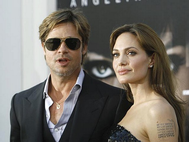 Salt Premiere Angelina Jolie and Brad Pitt in Hollywood - Angelina Jolie and Brad Pitt pose during the premiere of the action-thriller 'Salt' at Grauman's Chinese theatre in Hollywood, California (July 19, 2010). - , Salt, premiere, premieres, Angelina, Jolie, Brad, Pitt, Hollywood, celebrities, celebrity, actress, actresse, actor, actors, movie, movies, film, films, picture, pictures, action-thriller, action-thrillers, thriller, thrillers, adventure, adventures, Grauman's, Chinese, theatre, theatres, Hollywood, California - Angelina Jolie and Brad Pitt pose during the premiere of the action-thriller 'Salt' at Grauman's Chinese theatre in Hollywood, California (July 19, 2010). Solve free online Salt Premiere Angelina Jolie and Brad Pitt in Hollywood puzzle games or send Salt Premiere Angelina Jolie and Brad Pitt in Hollywood puzzle game greeting ecards  from puzzles-games.eu.. Salt Premiere Angelina Jolie and Brad Pitt in Hollywood puzzle, puzzles, puzzles games, puzzles-games.eu, puzzle games, online puzzle games, free puzzle games, free online puzzle games, Salt Premiere Angelina Jolie and Brad Pitt in Hollywood free puzzle game, Salt Premiere Angelina Jolie and Brad Pitt in Hollywood online puzzle game, jigsaw puzzles, Salt Premiere Angelina Jolie and Brad Pitt in Hollywood jigsaw puzzle, jigsaw puzzle games, jigsaw puzzles games, Salt Premiere Angelina Jolie and Brad Pitt in Hollywood puzzle game ecard, puzzles games ecards, Salt Premiere Angelina Jolie and Brad Pitt in Hollywood puzzle game greeting ecard