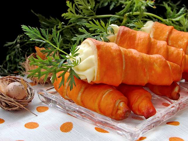 Easter Carrots - Original sweets for cup of coffee during the Easter feasts in shape of cones, filled with cream optional, from milk, vanilla, fruits or chocolate, which are decorated with fresh leaves of carrots. - , Easter, carrots, carrot, food, foods, holiday, holidays, feast, feasts, celebration, celebrations, original, sweets, sweet, cup, cups, coffee, shape, shapes, cones, cone, cream, creams, optional, milk, vanilla, fruit, fruits, chocolate, fresh, leaves, leaf, carrots, carrot - Original sweets for cup of coffee during the Easter feasts in shape of cones, filled with cream optional, from milk, vanilla, fruits or chocolate, which are decorated with fresh leaves of carrots. Solve free online Easter Carrots puzzle games or send Easter Carrots puzzle game greeting ecards  from puzzles-games.eu.. Easter Carrots puzzle, puzzles, puzzles games, puzzles-games.eu, puzzle games, online puzzle games, free puzzle games, free online puzzle games, Easter Carrots free puzzle game, Easter Carrots online puzzle game, jigsaw puzzles, Easter Carrots jigsaw puzzle, jigsaw puzzle games, jigsaw puzzles games, Easter Carrots puzzle game ecard, puzzles games ecards, Easter Carrots puzzle game greeting ecard