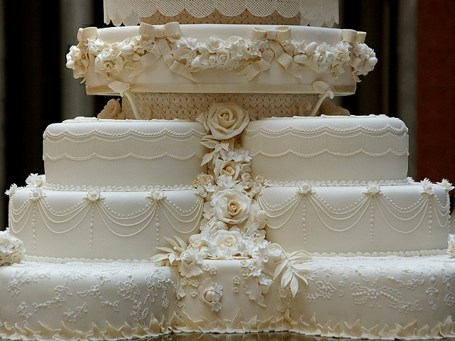 Royal Wedding Cake Close-up in Picture Gallery of Buckingham Palace London England - Close-up of the wedding cake for the royal reception of Prince William, Duke of Cambridge and his wife Catherine, Duchess of Cambridge, at the afternoon on April 29, 2011. The royal cake was made from 17 fruit cakes, decorated with cream, white icing, individually frozen through technique of Joseph Lambeth, 900 flowers and leaves of 17 different species. Around the middle, cake has a garland, looking like the architectural garlands around the top of the Picture Gallery in Buckingham Palace. - , Royal, wedding, weddings, cake, cakes, close-up, Picture, Gallery, galleries, Buckingham, palace, palaces, London, England, food, foods, celebrities, celebrity, show, shows, ceremony, ceremonies, event, events, entertainment, entertainments, place, places, travel, travels, tour, tours, reception, receptions, prince, princes, William, duke, dukes, Cambridge, wife, wifes, Catherine, duchess, duchesses, afternoon, afternoons, April, 2011, fruit, fruits, cream, creams, white, icing, technique, techniques, Joseph, Lambeth, flowers, flower, leaves, leaf, different, species, specie, middle, garland, garlands, architectural, top, tops - Close-up of the wedding cake for the royal reception of Prince William, Duke of Cambridge and his wife Catherine, Duchess of Cambridge, at the afternoon on April 29, 2011. The royal cake was made from 17 fruit cakes, decorated with cream, white icing, individually frozen through technique of Joseph Lambeth, 900 flowers and leaves of 17 different species. Around the middle, cake has a garland, looking like the architectural garlands around the top of the Picture Gallery in Buckingham Palace. Подреждайте безплатни онлайн Royal Wedding Cake Close-up in Picture Gallery of Buckingham Palace London England пъзел игри или изпратете Royal Wedding Cake Close-up in Picture Gallery of Buckingham Palace London England пъзел игра поздравителна картичка  от puzzles-games.eu.. Royal Wedding Cake Close-up in Picture Gallery of Buckingham Palace London England пъзел, пъзели, пъзели игри, puzzles-games.eu, пъзел игри, online пъзел игри, free пъзел игри, free online пъзел игри, Royal Wedding Cake Close-up in Picture Gallery of Buckingham Palace London England free пъзел игра, Royal Wedding Cake Close-up in Picture Gallery of Buckingham Palace London England online пъзел игра, jigsaw puzzles, Royal Wedding Cake Close-up in Picture Gallery of Buckingham Palace London England jigsaw puzzle, jigsaw puzzle games, jigsaw puzzles games, Royal Wedding Cake Close-up in Picture Gallery of Buckingham Palace London England пъзел игра картичка, пъзели игри картички, Royal Wedding Cake Close-up in Picture Gallery of Buckingham Palace London England пъзел игра поздравителна картичка