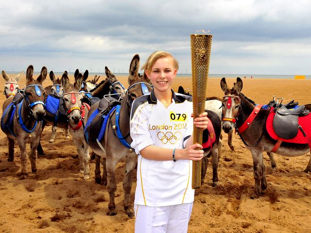 2012 London Olympics Torchbearer Starr Halley with Olympic Flame in Skegness England - Starr Halley, a 15-year-old student in King Edward VI Humanities College in Spilsby, with Olympic Flame in Skegness, England, a seaside town and resort in East Lindsey, on Lincolnshire coast of the North Sea (June 27, 2012) . She is one of 8,000 torchbearers in Torch Relay, which continued 70 days, traveled 8,000 miles and marked the start of the London Olympics. Starr Halley was diagnosed with a malignant brain tumour in 2009 and underwent a surgery and treatment. - , 2012, London, Olympics, torchbearer, torchbearers, Starr, Halley, Olympic, flame, flames, Skegness, England, show, shows, sport, sports, places, place, travel, travels, tour, tours, trip, trips, student, students, King, Edward, Humanities, college, colleges, Spilsby, seaside, town, towns, resort, resorts, East, Lindsey, Lincolnshire, North, Sea, June, torch, torches, relay, relays, days, day, miles, mile, start, stars, malignant, brain, brains, tumour, tumors, 2009, surgery, surgeries, treatment, treatments - Starr Halley, a 15-year-old student in King Edward VI Humanities College in Spilsby, with Olympic Flame in Skegness, England, a seaside town and resort in East Lindsey, on Lincolnshire coast of the North Sea (June 27, 2012) . She is one of 8,000 torchbearers in Torch Relay, which continued 70 days, traveled 8,000 miles and marked the start of the London Olympics. Starr Halley was diagnosed with a malignant brain tumour in 2009 and underwent a surgery and treatment. Solve free online 2012 London Olympics Torchbearer Starr Halley with Olympic Flame in Skegness England puzzle games or send 2012 London Olympics Torchbearer Starr Halley with Olympic Flame in Skegness England puzzle game greeting ecards  from puzzles-games.eu.. 2012 London Olympics Torchbearer Starr Halley with Olympic Flame in Skegness England puzzle, puzzles, puzzles games, puzzles-games.eu, puzzle games, online puzzle games, free puzzle games, free online puzzle games, 2012 London Olympics Torchbearer Starr Halley with Olympic Flame in Skegness England free puzzle game, 2012 London Olympics Torchbearer Starr Halley with Olympic Flame in Skegness England online puzzle game, jigsaw puzzles, 2012 London Olympics Torchbearer Starr Halley with Olympic Flame in Skegness England jigsaw puzzle, jigsaw puzzle games, jigsaw puzzles games, 2012 London Olympics Torchbearer Starr Halley with Olympic Flame in Skegness England puzzle game ecard, puzzles games ecards, 2012 London Olympics Torchbearer Starr Halley with Olympic Flame in Skegness England puzzle game greeting ecard