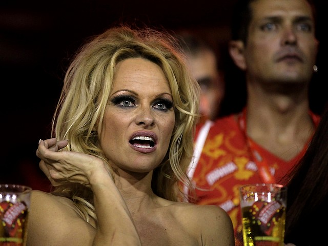Rio Carnival Brazil 2011 Pamela Anderson - Pamela Anderson, a Canadian American actress, model and producer, looks on the carnival parade along he Sambadrome in Rio de Janeiro, Brazil (March 6, 2011). - , Rio, carnival, carnivals, Brazil, 2011, Pamela, Anderson, show, shows, place, places, celebrities, celebrity, celebrations, celebration, festival, festivals, feast, amusement, amusements, holidays, holiday, places, place, travel, travels, tour, tours, trips, trip, Canadian, American, actress, actresses, model, models, producer, producers, parade, parades, Sambadrome, Janeiro, March - Pamela Anderson, a Canadian American actress, model and producer, looks on the carnival parade along he Sambadrome in Rio de Janeiro, Brazil (March 6, 2011). Solve free online Rio Carnival Brazil 2011 Pamela Anderson puzzle games or send Rio Carnival Brazil 2011 Pamela Anderson puzzle game greeting ecards  from puzzles-games.eu.. Rio Carnival Brazil 2011 Pamela Anderson puzzle, puzzles, puzzles games, puzzles-games.eu, puzzle games, online puzzle games, free puzzle games, free online puzzle games, Rio Carnival Brazil 2011 Pamela Anderson free puzzle game, Rio Carnival Brazil 2011 Pamela Anderson online puzzle game, jigsaw puzzles, Rio Carnival Brazil 2011 Pamela Anderson jigsaw puzzle, jigsaw puzzle games, jigsaw puzzles games, Rio Carnival Brazil 2011 Pamela Anderson puzzle game ecard, puzzles games ecards, Rio Carnival Brazil 2011 Pamela Anderson puzzle game greeting ecard
