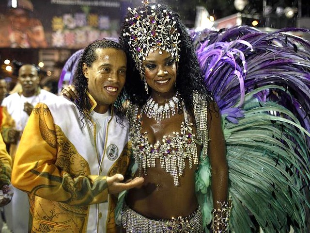 Rio Carnival Brazil 2011 Ronaldinho and Cris Vianna - The Brazilian soccer player Ronaldinho and Cris Vianna, queen of the drums of the 'Grande Rio' samba school, during the carnival parade at the Sambadrome in Rio de Janeiro, Brazil (March 8, 2011). - , Rio, carnival, carnivals, Brazil, 2011, Ronaldinho, Cris, Vianna, show, shows, place, places, celebrations, celebration, festival, festivals, feast, amusement, amusements, holidays, holiday, places, place, travel, travels, tour, tours, trips, trip, Brazilian, soccer, player, players, queen, queens, drums, drum, Grande, samba, school, schools, parade, parades, Sambadrome, Janeiro, March - The Brazilian soccer player Ronaldinho and Cris Vianna, queen of the drums of the 'Grande Rio' samba school, during the carnival parade at the Sambadrome in Rio de Janeiro, Brazil (March 8, 2011). Solve free online Rio Carnival Brazil 2011 Ronaldinho and Cris Vianna puzzle games or send Rio Carnival Brazil 2011 Ronaldinho and Cris Vianna puzzle game greeting ecards  from puzzles-games.eu.. Rio Carnival Brazil 2011 Ronaldinho and Cris Vianna puzzle, puzzles, puzzles games, puzzles-games.eu, puzzle games, online puzzle games, free puzzle games, free online puzzle games, Rio Carnival Brazil 2011 Ronaldinho and Cris Vianna free puzzle game, Rio Carnival Brazil 2011 Ronaldinho and Cris Vianna online puzzle game, jigsaw puzzles, Rio Carnival Brazil 2011 Ronaldinho and Cris Vianna jigsaw puzzle, jigsaw puzzle games, jigsaw puzzles games, Rio Carnival Brazil 2011 Ronaldinho and Cris Vianna puzzle game ecard, puzzles games ecards, Rio Carnival Brazil 2011 Ronaldinho and Cris Vianna puzzle game greeting ecard
