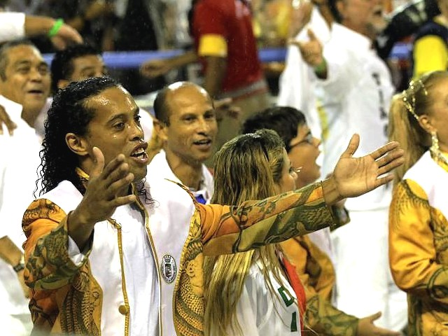 Rio Carnival Brazil 2011 Ronaldinho sings with Grande Rio Samba School - Soccer star Ronaldinho sings together with the participants from the 'Grande Rio' samba school, during the carnival parade along the Sambadrome in Rio de Janeiro, Brazil (March 8, 2011). - , Rio, carnival, carnivals, Brazil, 2011, Ronaldinho, Grande, samba, school, schools, show, shows, place, places, celebrations, celebration, festival, festivals, feast, amusement, amusements, holidays, holiday, places, place, travel, travels, tour, tours, trips, trip, soccer, star, stars, participants, participant, parade, parades, Sambadrome, Janeiro, March - Soccer star Ronaldinho sings together with the participants from the 'Grande Rio' samba school, during the carnival parade along the Sambadrome in Rio de Janeiro, Brazil (March 8, 2011). Solve free online Rio Carnival Brazil 2011 Ronaldinho sings with Grande Rio Samba School puzzle games or send Rio Carnival Brazil 2011 Ronaldinho sings with Grande Rio Samba School puzzle game greeting ecards  from puzzles-games.eu.. Rio Carnival Brazil 2011 Ronaldinho sings with Grande Rio Samba School puzzle, puzzles, puzzles games, puzzles-games.eu, puzzle games, online puzzle games, free puzzle games, free online puzzle games, Rio Carnival Brazil 2011 Ronaldinho sings with Grande Rio Samba School free puzzle game, Rio Carnival Brazil 2011 Ronaldinho sings with Grande Rio Samba School online puzzle game, jigsaw puzzles, Rio Carnival Brazil 2011 Ronaldinho sings with Grande Rio Samba School jigsaw puzzle, jigsaw puzzle games, jigsaw puzzles games, Rio Carnival Brazil 2011 Ronaldinho sings with Grande Rio Samba School puzzle game ecard, puzzles games ecards, Rio Carnival Brazil 2011 Ronaldinho sings with Grande Rio Samba School puzzle game greeting ecard