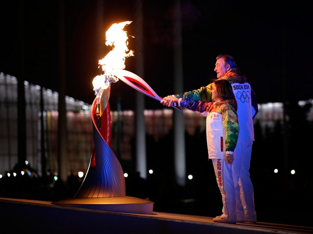 Sochi 2014 Winter Olympics Vladislav Tretiak and Irina Rodnina lit Olympic Flame - Vladislav Tretiak, the former hockey player and the best goalie during the 1970s and '80s, and Irina Rodnina, figure skater  who won three straight Olympic titles, lit the Olympic flame during the Opening Ceremony of the Sochi Winter Olympics on February 7, 2014. Other torchbearers in the final group were tennis star Maria Sharapova, Olympic pole vault champion Yelena Isinbayeva, three-time Olympic champion wrestler Alexander Karelin and Alina Kabayeva, a former Olympic champion gymnast. - , Sochi, 2014, Winter, Olympics, Vladislav, Tretiak, Irina, Rodnina, olympic, flame, flames, show, shows, sport, sports, celebrities, celebrity, former, hockey, player, players, goalie, goalies, 1970s, figure, skater, skaters, titles, title, opening, ceremony, ceremonies, February, torchbearers, torchbearer, final, group, groups, tennis, star, stars, Maria, Sharapova, pole, vault, champion, champions, Yelena, Isinbayeva, wrestler, Alexander, Karelin, Alina, Kabayeva, gymnast - Vladislav Tretiak, the former hockey player and the best goalie during the 1970s and '80s, and Irina Rodnina, figure skater  who won three straight Olympic titles, lit the Olympic flame during the Opening Ceremony of the Sochi Winter Olympics on February 7, 2014. Other torchbearers in the final group were tennis star Maria Sharapova, Olympic pole vault champion Yelena Isinbayeva, three-time Olympic champion wrestler Alexander Karelin and Alina Kabayeva, a former Olympic champion gymnast. Solve free online Sochi 2014 Winter Olympics Vladislav Tretiak and Irina Rodnina lit Olympic Flame puzzle games or send Sochi 2014 Winter Olympics Vladislav Tretiak and Irina Rodnina lit Olympic Flame puzzle game greeting ecards  from puzzles-games.eu.. Sochi 2014 Winter Olympics Vladislav Tretiak and Irina Rodnina lit Olympic Flame puzzle, puzzles, puzzles games, puzzles-games.eu, puzzle games, online puzzle games, free puzzle games, free online puzzle games, Sochi 2014 Winter Olympics Vladislav Tretiak and Irina Rodnina lit Olympic Flame free puzzle game, Sochi 2014 Winter Olympics Vladislav Tretiak and Irina Rodnina lit Olympic Flame online puzzle game, jigsaw puzzles, Sochi 2014 Winter Olympics Vladislav Tretiak and Irina Rodnina lit Olympic Flame jigsaw puzzle, jigsaw puzzle games, jigsaw puzzles games, Sochi 2014 Winter Olympics Vladislav Tretiak and Irina Rodnina lit Olympic Flame puzzle game ecard, puzzles games ecards, Sochi 2014 Winter Olympics Vladislav Tretiak and Irina Rodnina lit Olympic Flame puzzle game greeting ecard