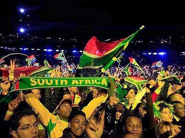 World Cup 2010 Kick-off Concert Fans - Fans wave flags and raise scarves during the Kick-off Celebration concert for the FIFA World Cup 2010 at the Orlando stadium in Soweto, Johannesburg, South Africa (June 10, 2010). - , World, Cup, 2010, Kick-off, concert, concerts, fans, fan, show, shows, performance, performances, sport, sports, tournament, tournaments, qualification, qualifications, ceremony, ceremonies, flags, flag, scarve, scarves, celebration, FIFA, Orlando, stadium, stadiums, Soweto, Johannesburg, South, Africa - Fans wave flags and raise scarves during the Kick-off Celebration concert for the FIFA World Cup 2010 at the Orlando stadium in Soweto, Johannesburg, South Africa (June 10, 2010). Solve free online World Cup 2010 Kick-off Concert Fans puzzle games or send World Cup 2010 Kick-off Concert Fans puzzle game greeting ecards  from puzzles-games.eu.. World Cup 2010 Kick-off Concert Fans puzzle, puzzles, puzzles games, puzzles-games.eu, puzzle games, online puzzle games, free puzzle games, free online puzzle games, World Cup 2010 Kick-off Concert Fans free puzzle game, World Cup 2010 Kick-off Concert Fans online puzzle game, jigsaw puzzles, World Cup 2010 Kick-off Concert Fans jigsaw puzzle, jigsaw puzzle games, jigsaw puzzles games, World Cup 2010 Kick-off Concert Fans puzzle game ecard, puzzles games ecards, World Cup 2010 Kick-off Concert Fans puzzle game greeting ecard