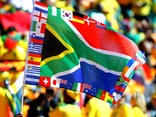 World Cup 2010 South African Flag - A South African flag with incorporated national flags of all participants in the FIFA World Cup 2010 tournament waves during the Opening Ceremony at the Soccer City stadium in Johannesburg, South Africa (June 11, 2010). - , World, Cup, 2010, South, African, flag, flags, show, shows, sport, sports, tournament, tournaments, performance, performances, incorporated, national, participants, participant, FIFA, Opening, Ceremony, ceremonies, Soccer, City, stadium, stadiums, Johannesburg, South, Africa - A South African flag with incorporated national flags of all participants in the FIFA World Cup 2010 tournament waves during the Opening Ceremony at the Soccer City stadium in Johannesburg, South Africa (June 11, 2010). Solve free online World Cup 2010 South African Flag puzzle games or send World Cup 2010 South African Flag puzzle game greeting ecards  from puzzles-games.eu.. World Cup 2010 South African Flag puzzle, puzzles, puzzles games, puzzles-games.eu, puzzle games, online puzzle games, free puzzle games, free online puzzle games, World Cup 2010 South African Flag free puzzle game, World Cup 2010 South African Flag online puzzle game, jigsaw puzzles, World Cup 2010 South African Flag jigsaw puzzle, jigsaw puzzle games, jigsaw puzzles games, World Cup 2010 South African Flag puzzle game ecard, puzzles games ecards, World Cup 2010 South African Flag puzzle game greeting ecard