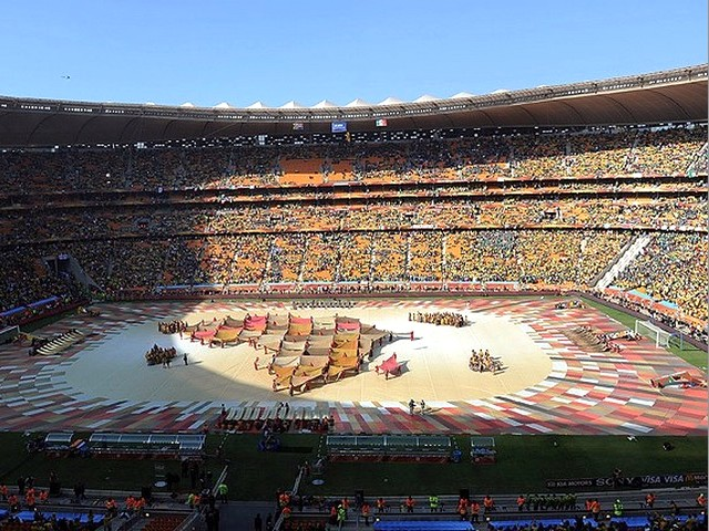 World Cup 2010 a Map of Africa - Performers form a map of Africa from coloured blankets while Timothy Moloi sings the World Cup anthem 'Hope' during the Opening Ceremony of the FIFA World Cup 2010 at the Soccer City stadium in Johannesburg, South Africa (June 11, 2010). - , World, Cup, 2010, map, maps, Africa, show, shows, performance, performances, sport, sports, tournament, tournaments, qualification, qualifications, ceremony, ceremonies, match, matches, performer, performers, blanket, blankets, Timothy, Moloi, anthem, anthems, 'Hope', Opening, FIFA, Soccer, City, stadium, stadiums, Johannesburg, South - Performers form a map of Africa from coloured blankets while Timothy Moloi sings the World Cup anthem 'Hope' during the Opening Ceremony of the FIFA World Cup 2010 at the Soccer City stadium in Johannesburg, South Africa (June 11, 2010). Solve free online World Cup 2010 a Map of Africa puzzle games or send World Cup 2010 a Map of Africa puzzle game greeting ecards  from puzzles-games.eu.. World Cup 2010 a Map of Africa puzzle, puzzles, puzzles games, puzzles-games.eu, puzzle games, online puzzle games, free puzzle games, free online puzzle games, World Cup 2010 a Map of Africa free puzzle game, World Cup 2010 a Map of Africa online puzzle game, jigsaw puzzles, World Cup 2010 a Map of Africa jigsaw puzzle, jigsaw puzzle games, jigsaw puzzles games, World Cup 2010 a Map of Africa puzzle game ecard, puzzles games ecards, World Cup 2010 a Map of Africa puzzle game greeting ecard