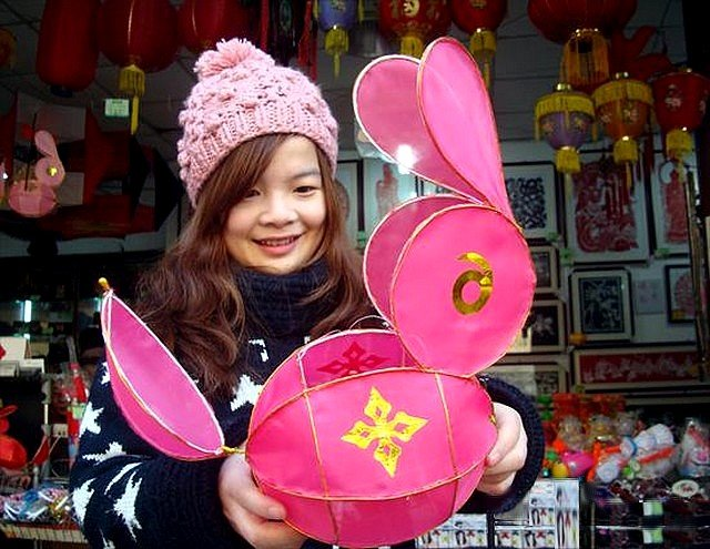 Chinese New Year in Suzhou Jiangsu East China - A girl with a lantern shaped as rabbit during celebrations of the Chinese New Year, on the street in Suzhou, a cultural and historical city world known with its elegant gardens, in Jiangsu province, East China (Jan 25, 2011). - , Chinese, New, Year, years, Suzhou, Jiangsu, East, China, holidays, holiday, festival, festivals, celebrations, celebration, places, place, holidays, holiday, travel, travels, tour, tours, trips, trip, excursion, excursions, girl, girls, lantern, lanterns, rabbit, rabbits, street, streets, cultural, historical, city, cities, elegant, gardens, garden, province, provinces - A girl with a lantern shaped as rabbit during celebrations of the Chinese New Year, on the street in Suzhou, a cultural and historical city world known with its elegant gardens, in Jiangsu province, East China (Jan 25, 2011). Solve free online Chinese New Year in Suzhou Jiangsu East China puzzle games or send Chinese New Year in Suzhou Jiangsu East China puzzle game greeting ecards  from puzzles-games.eu.. Chinese New Year in Suzhou Jiangsu East China puzzle, puzzles, puzzles games, puzzles-games.eu, puzzle games, online puzzle games, free puzzle games, free online puzzle games, Chinese New Year in Suzhou Jiangsu East China free puzzle game, Chinese New Year in Suzhou Jiangsu East China online puzzle game, jigsaw puzzles, Chinese New Year in Suzhou Jiangsu East China jigsaw puzzle, jigsaw puzzle games, jigsaw puzzles games, Chinese New Year in Suzhou Jiangsu East China puzzle game ecard, puzzles games ecards, Chinese New Year in Suzhou Jiangsu East China puzzle game greeting ecard
