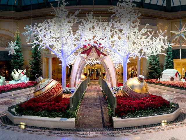 Christmas at Bellagio Conservatory and Botanical Gardens Las Vegas Nevada - Giant Christmas ornaments and four 18-foot white LED trees covered in faux snow, which create path for walk-through a 13-foot see-through arch with snowflakes. The winter display is one of five seasonal themes, situated at the entrance of the Bellagio Conservatory and Botanical Gardens in Las Vegas, Nevada. The Bellagio Conservatory changes its decor with the changing of the seasons, winter, spring, summer, fall and Chinese New Year. - , Christmas, Bellagio, Conservatory, Botanical, Gardens, garden, Las, Vegas, Nevada, holiday, holidays, places, place, giant, ornaments, ornament, white, LED, trees, tree, faux, snow, path, paths, arch, arches, snowflakes, snowflake, winter, display, seasonal, themes, theme, entrance, entrances, decor, decors, seasons, season, spring, summer, fall, Chinese, New, Year - Giant Christmas ornaments and four 18-foot white LED trees covered in faux snow, which create path for walk-through a 13-foot see-through arch with snowflakes. The winter display is one of five seasonal themes, situated at the entrance of the Bellagio Conservatory and Botanical Gardens in Las Vegas, Nevada. The Bellagio Conservatory changes its decor with the changing of the seasons, winter, spring, summer, fall and Chinese New Year. Solve free online Christmas at Bellagio Conservatory and Botanical Gardens Las Vegas Nevada puzzle games or send Christmas at Bellagio Conservatory and Botanical Gardens Las Vegas Nevada puzzle game greeting ecards  from puzzles-games.eu.. Christmas at Bellagio Conservatory and Botanical Gardens Las Vegas Nevada puzzle, puzzles, puzzles games, puzzles-games.eu, puzzle games, online puzzle games, free puzzle games, free online puzzle games, Christmas at Bellagio Conservatory and Botanical Gardens Las Vegas Nevada free puzzle game, Christmas at Bellagio Conservatory and Botanical Gardens Las Vegas Nevada online puzzle game, jigsaw puzzles, Christmas at Bellagio Conservatory and Botanical Gardens Las Vegas Nevada jigsaw puzzle, jigsaw puzzle games, jigsaw puzzles games, Christmas at Bellagio Conservatory and Botanical Gardens Las Vegas Nevada puzzle game ecard, puzzles games ecards, Christmas at Bellagio Conservatory and Botanical Gardens Las Vegas Nevada puzzle game greeting ecard