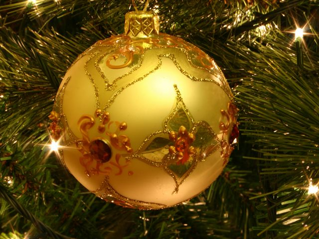 Golden Christmas Tree Bauble - A magnificent hand-painted golden bauble, used as decorations on Christmas trees. The Christmas baubles are small brittle hollow glass spheres, coated with a thin reflective metallic layer, topped with a cap, hook and tinsel or ribbon. Since the late 19th century were a specialty of the glass factories in the Thuringian Forest, especially in Lauscha, Germany. Tsar Peter I was the one who introduced the Russian custom to decorate a Christmas trees. - , golden, Christmas, tree, trees, bauble, holiday, holidays, art, arts, magnificent, hand-painted, decorations, decoration, small, brittle, hollow, glass, spheres, sphere, reflective, metallic, layer, cap, caps, hook, hooks, tinsel, ribbon, ribbons, century, centuries, specialty, factories, factory, Thuringian, Forest, Lauscha, Germany, tsar, Peter, Russian, custom, customs - A magnificent hand-painted golden bauble, used as decorations on Christmas trees. The Christmas baubles are small brittle hollow glass spheres, coated with a thin reflective metallic layer, topped with a cap, hook and tinsel or ribbon. Since the late 19th century were a specialty of the glass factories in the Thuringian Forest, especially in Lauscha, Germany. Tsar Peter I was the one who introduced the Russian custom to decorate a Christmas trees. Solve free online Golden Christmas Tree Bauble puzzle games or send Golden Christmas Tree Bauble puzzle game greeting ecards  from puzzles-games.eu.. Golden Christmas Tree Bauble puzzle, puzzles, puzzles games, puzzles-games.eu, puzzle games, online puzzle games, free puzzle games, free online puzzle games, Golden Christmas Tree Bauble free puzzle game, Golden Christmas Tree Bauble online puzzle game, jigsaw puzzles, Golden Christmas Tree Bauble jigsaw puzzle, jigsaw puzzle games, jigsaw puzzles games, Golden Christmas Tree Bauble puzzle game ecard, puzzles games ecards, Golden Christmas Tree Bauble puzzle game greeting ecard