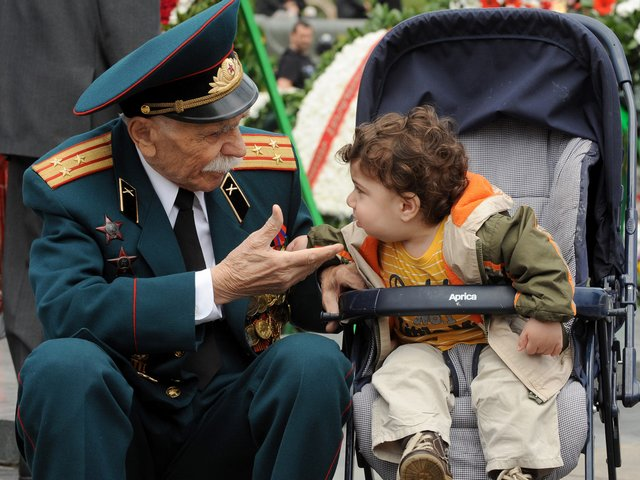 Victory Day Veteran of WWII in Yerevan Armenia - A veteran of WWII speaks with a little child in the Armenian capital Yerevan, during the celebrations of Victory Day. <br /> As the other former Soviet republics, Armenia commemorates on May 9 the victory of the Red Army over the Nazi forces in the Second World War, known as the Great Patriotic War. The holiday was officially recognized by Armenia since the independence in 1990. - , Victory, Day, days, veteran, veterans, WWII, Yerevan, Armenia, holiday, holidays, little, child, children, Armenian, capital, capitals, celebrations, celebration, former, Soviet, republics, republic, Red, Army, armies, Nazi, forces, force, Second, World, War, wars, Great, Patriotic, independence, 1990 - A veteran of WWII speaks with a little child in the Armenian capital Yerevan, during the celebrations of Victory Day. <br /> As the other former Soviet republics, Armenia commemorates on May 9 the victory of the Red Army over the Nazi forces in the Second World War, known as the Great Patriotic War. The holiday was officially recognized by Armenia since the independence in 1990. Solve free online Victory Day Veteran of WWII in Yerevan Armenia puzzle games or send Victory Day Veteran of WWII in Yerevan Armenia puzzle game greeting ecards  from puzzles-games.eu.. Victory Day Veteran of WWII in Yerevan Armenia puzzle, puzzles, puzzles games, puzzles-games.eu, puzzle games, online puzzle games, free puzzle games, free online puzzle games, Victory Day Veteran of WWII in Yerevan Armenia free puzzle game, Victory Day Veteran of WWII in Yerevan Armenia online puzzle game, jigsaw puzzles, Victory Day Veteran of WWII in Yerevan Armenia jigsaw puzzle, jigsaw puzzle games, jigsaw puzzles games, Victory Day Veteran of WWII in Yerevan Armenia puzzle game ecard, puzzles games ecards, Victory Day Veteran of WWII in Yerevan Armenia puzzle game greeting ecard