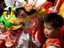 Spring Festival Boy with Colourful Dragon Mask