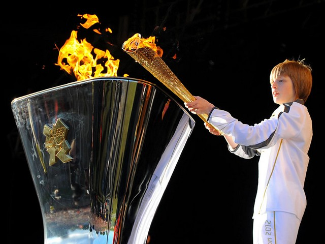 2012 Summer Olympics Torch Bearer Aaron Bell lighted Golden Cauldron in Leeds UK - The 13-year-old torch bearer Aaron Bell lighted the Golden Cauldron with the Olympic Flame on a specially erected stage at the estate of Temple Newsam in Leeds (24 June 2012) during the Olympic Torch Relay, before the opening of the Summer Olympics in London, UK. Aaron Bell from Halifax, selected by Coca-Cola for a flame carrier, is passionate about karate and has a 7th Dan Black Belt. - , 2012, Summer, Olympics, torch, torches, bearer, bearers, Aaron, Bell, golden, cauldron, cauldrons, Leeds, UK, places, place, show, shows, sport, sports, travel, travels, tour, tours, trip, trips, Olympic, flame, flames, stage, stages, estate, estates, Temple, temples, Newsam, June, London, Halifax, Coca-Cola, Coca, Cola, carrier, carriers, passionate, karate, 7th, Dan, Black, Belt, belts - The 13-year-old torch bearer Aaron Bell lighted the Golden Cauldron with the Olympic Flame on a specially erected stage at the estate of Temple Newsam in Leeds (24 June 2012) during the Olympic Torch Relay, before the opening of the Summer Olympics in London, UK. Aaron Bell from Halifax, selected by Coca-Cola for a flame carrier, is passionate about karate and has a 7th Dan Black Belt. Solve free online 2012 Summer Olympics Torch Bearer Aaron Bell lighted Golden Cauldron in Leeds UK puzzle games or send 2012 Summer Olympics Torch Bearer Aaron Bell lighted Golden Cauldron in Leeds UK puzzle game greeting ecards  from puzzles-games.eu.. 2012 Summer Olympics Torch Bearer Aaron Bell lighted Golden Cauldron in Leeds UK puzzle, puzzles, puzzles games, puzzles-games.eu, puzzle games, online puzzle games, free puzzle games, free online puzzle games, 2012 Summer Olympics Torch Bearer Aaron Bell lighted Golden Cauldron in Leeds UK free puzzle game, 2012 Summer Olympics Torch Bearer Aaron Bell lighted Golden Cauldron in Leeds UK online puzzle game, jigsaw puzzles, 2012 Summer Olympics Torch Bearer Aaron Bell lighted Golden Cauldron in Leeds UK jigsaw puzzle, jigsaw puzzle games, jigsaw puzzles games, 2012 Summer Olympics Torch Bearer Aaron Bell lighted Golden Cauldron in Leeds UK puzzle game ecard, puzzles games ecards, 2012 Summer Olympics Torch Bearer Aaron Bell lighted Golden Cauldron in Leeds UK puzzle game greeting ecard